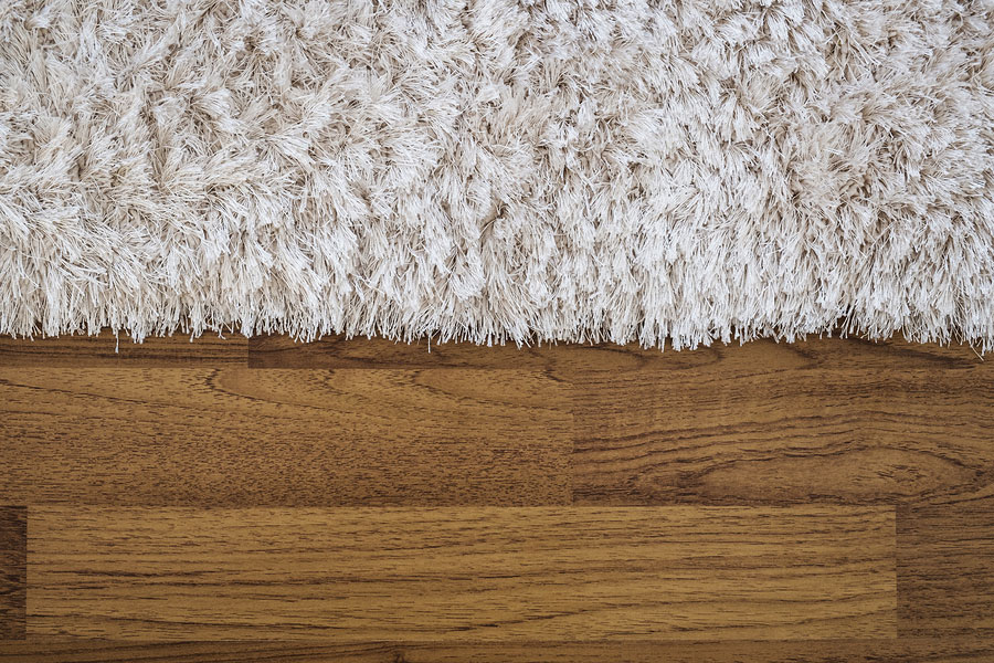 How to Weigh the Costs of Carpet vs Hardwood Flooring
